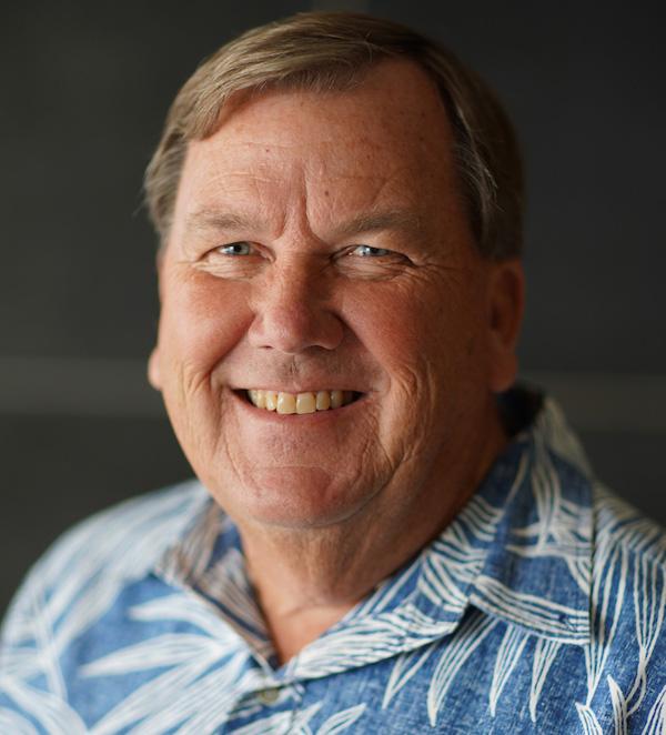 Robert Roper Smiling Wearing Blue Hawaiian Shirt